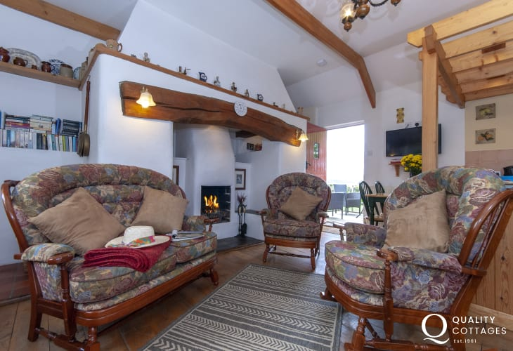 Lawrenny cosy holiday cottage sitting room with Inglenook and open fire