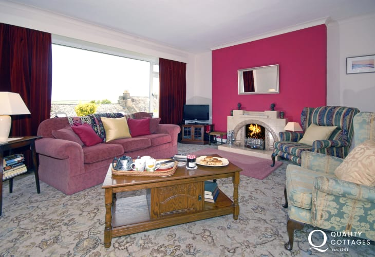 Newport holiday family home - lounge with open coal/wood burning fire