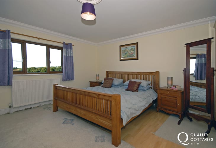 Super kingsize master bedroom with countryside views