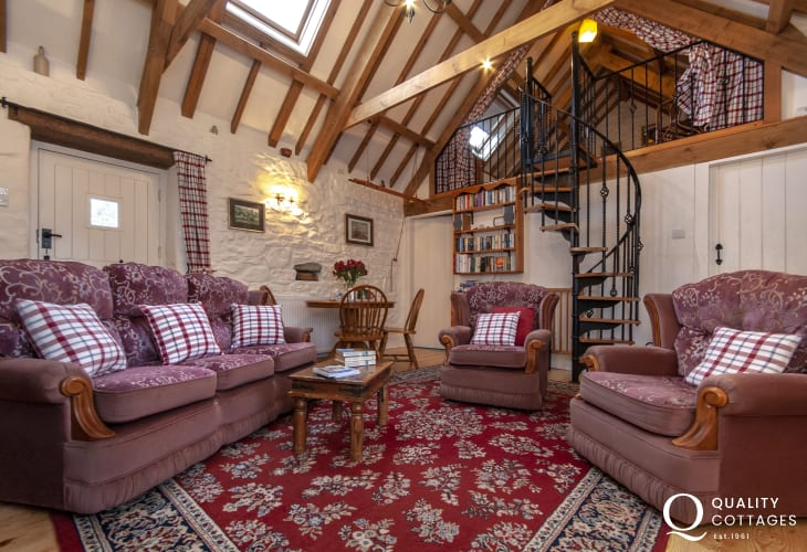 Pet friendly coastal cottage - cosy sitting/dining room with wifi and log burner