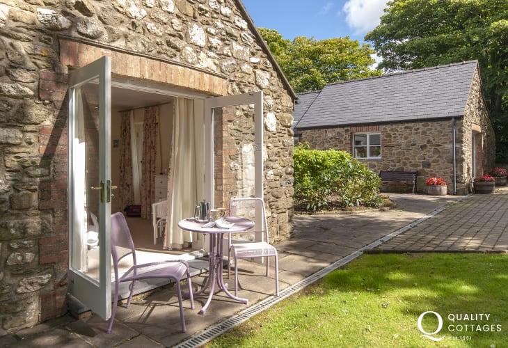 Lochturffin Barns - French doors to garden from the kingsize bedroom