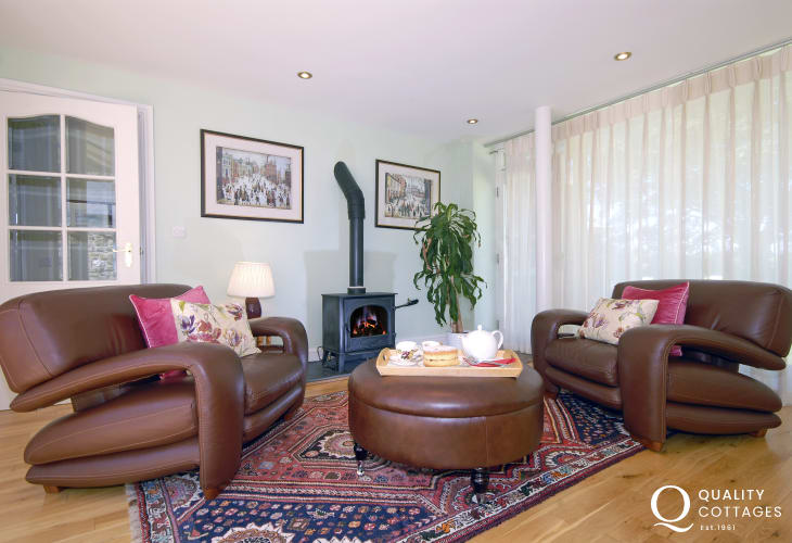 Spacious lounge with 65 inch flat screen television - Sky TV