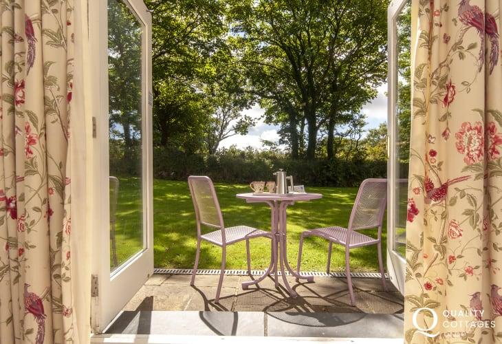 Patio doors to gardens from kingsize bedroom