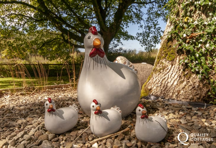 Ceramic hens peeping from the bushes