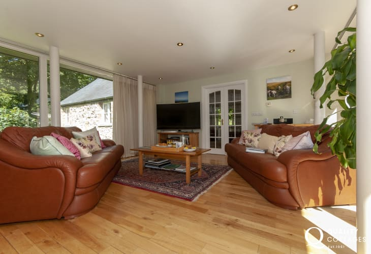 Luxury holiday home in North Pembrokeshire - lounge with floor to ceiling glass walls
