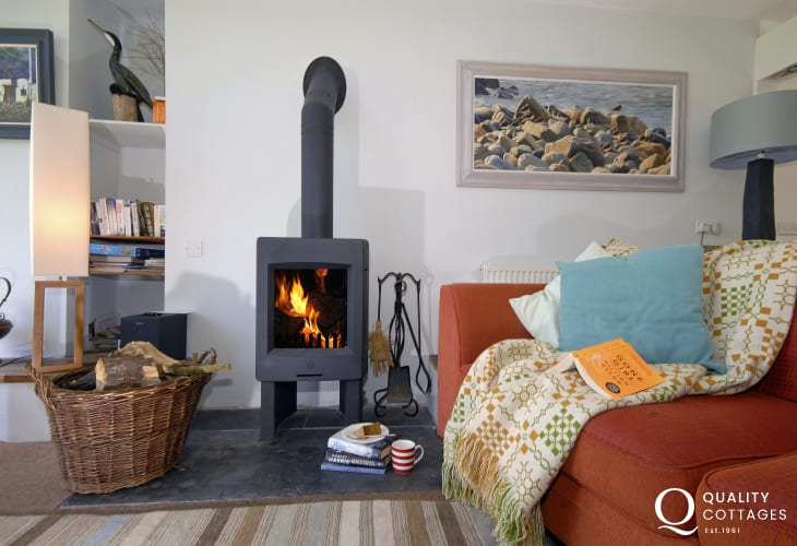 Chill out and curl up by the wood burning stove at The Burgage