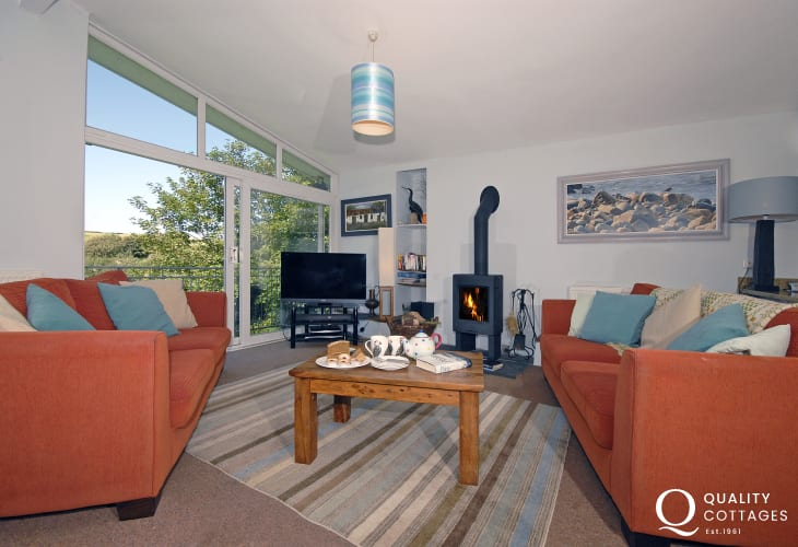 Nolton Haven 1960's contemporary home - open plan living room with wood burning stove