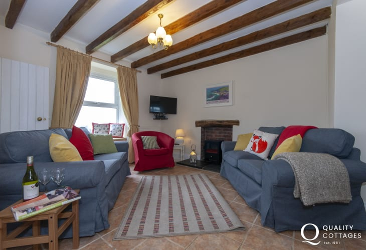 Pembrokeshire cosy holiday cottage - open plan sitting room with log-effect electric stove
