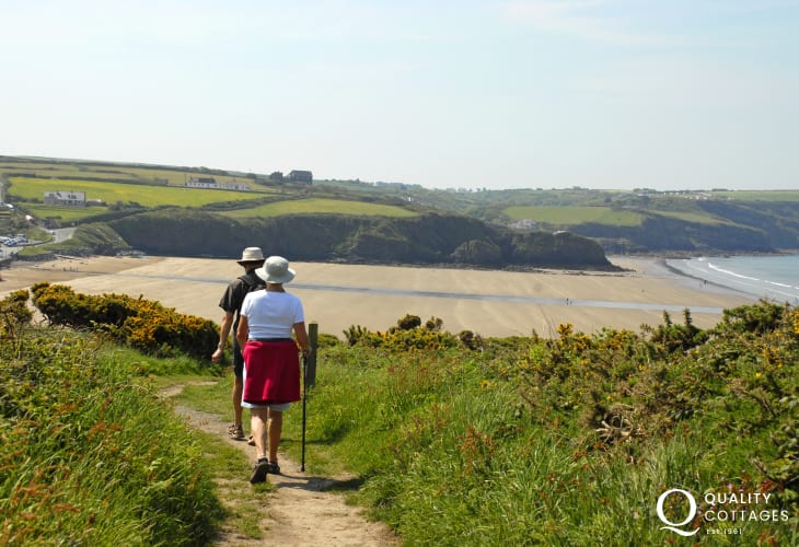 The Pembrokeshire Coastal Path winds down from the garden to Broad Haven beach