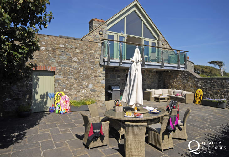 St Davids holiday barn conversion with secluded rear patio gardens and Rattan furniture