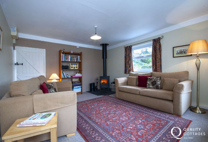Solva Valley holiday cottage - living room with WiFi and log burner