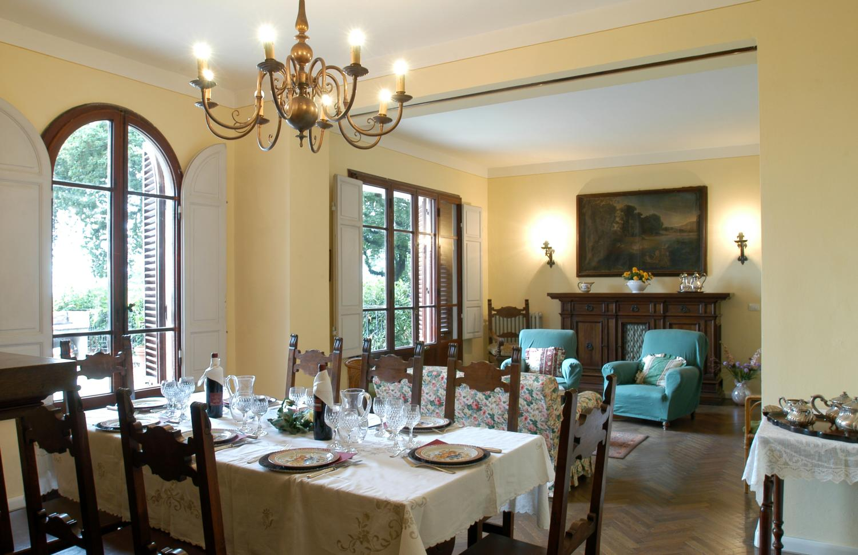Dining room and lounge with fireplace, Borgo Raffaello, Tuscany, Pistoia.