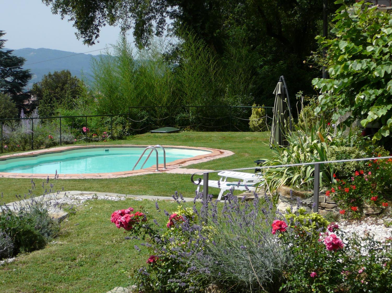 Garden and pool, Borgo Raffaello, Tuscany, Pistoia.