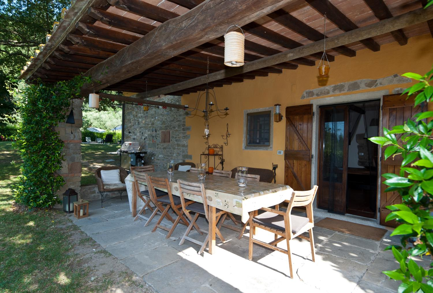 Outdoor sheltered dining table, Casa Vilaggio, Tuscany, Luco di Mugello.