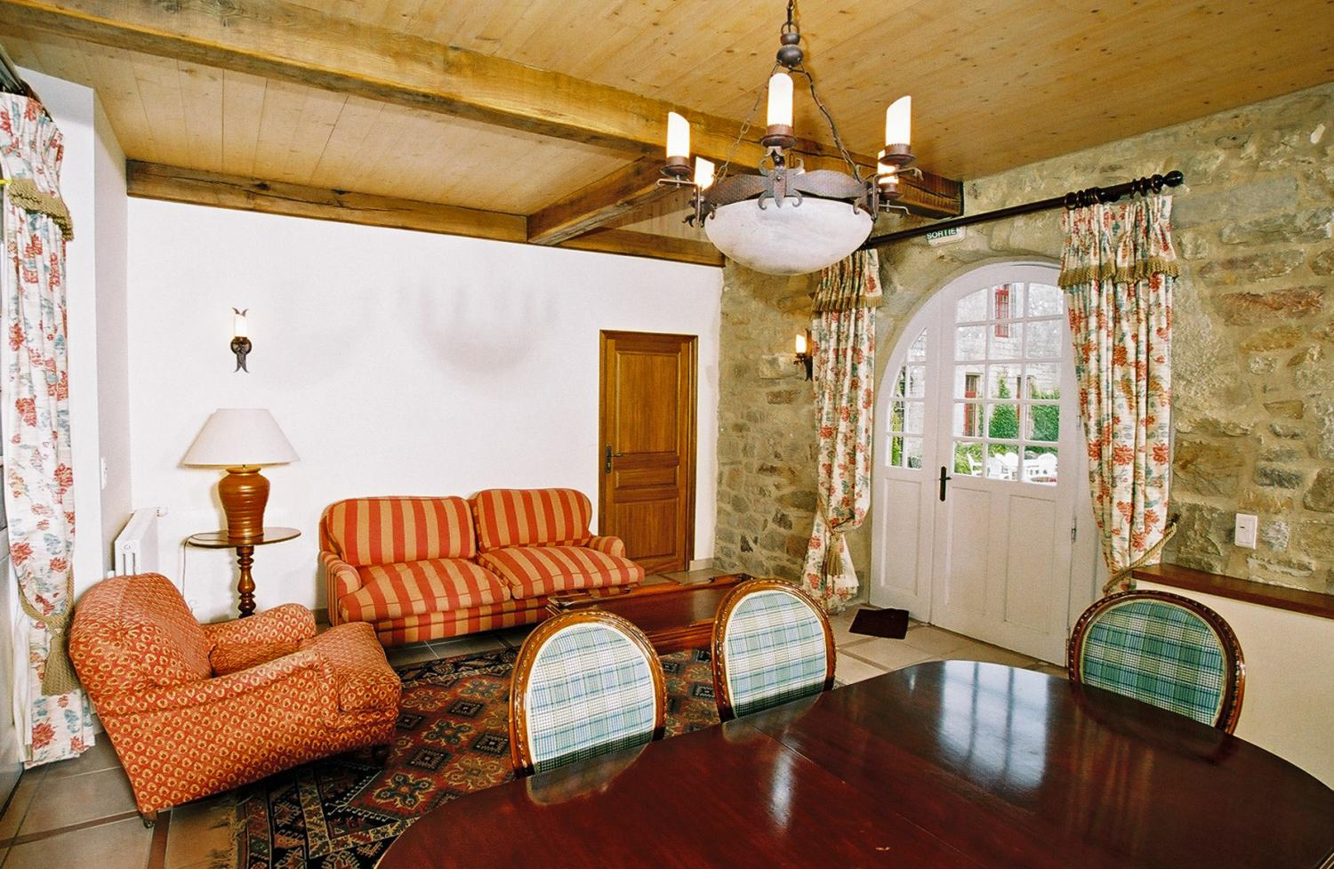 Lounge and dining table, Breton Manor - Garden Wing, Brittany, Audierne.