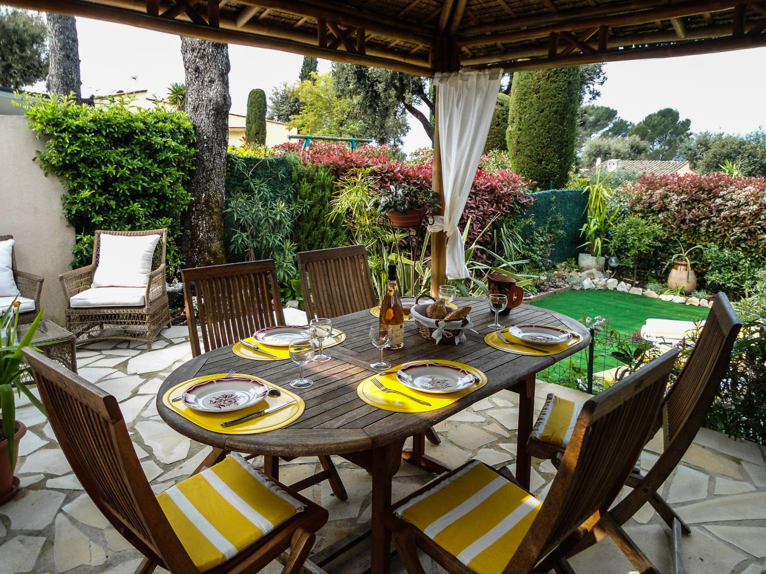 outdoor dining at french villa with shared pool