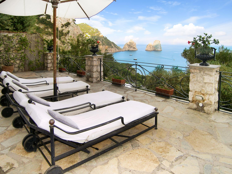 Sun Loungers, Faraglioni di Capri, Island of Capri, Amalfi Coast Campania.