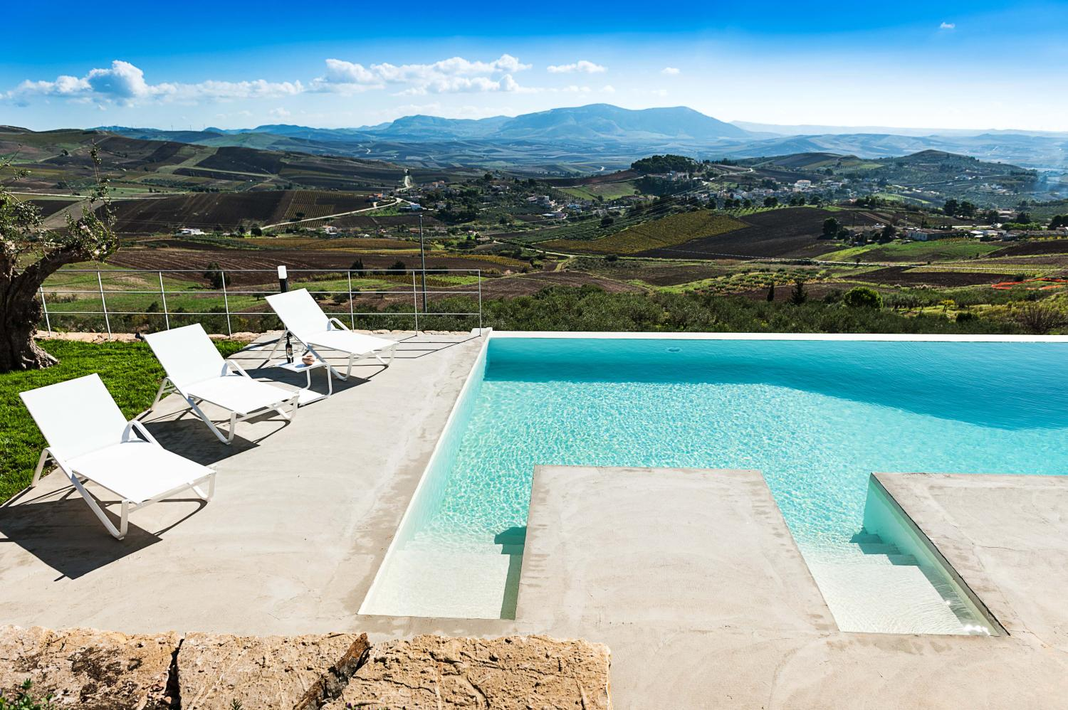 Outdoor pool and sun loungers, Amaryllis, Sicily, Trapani.