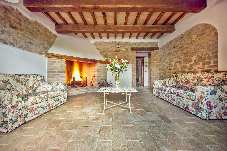 Lounge with fireplace, Casa Benazzone, Umbria, Perugia.