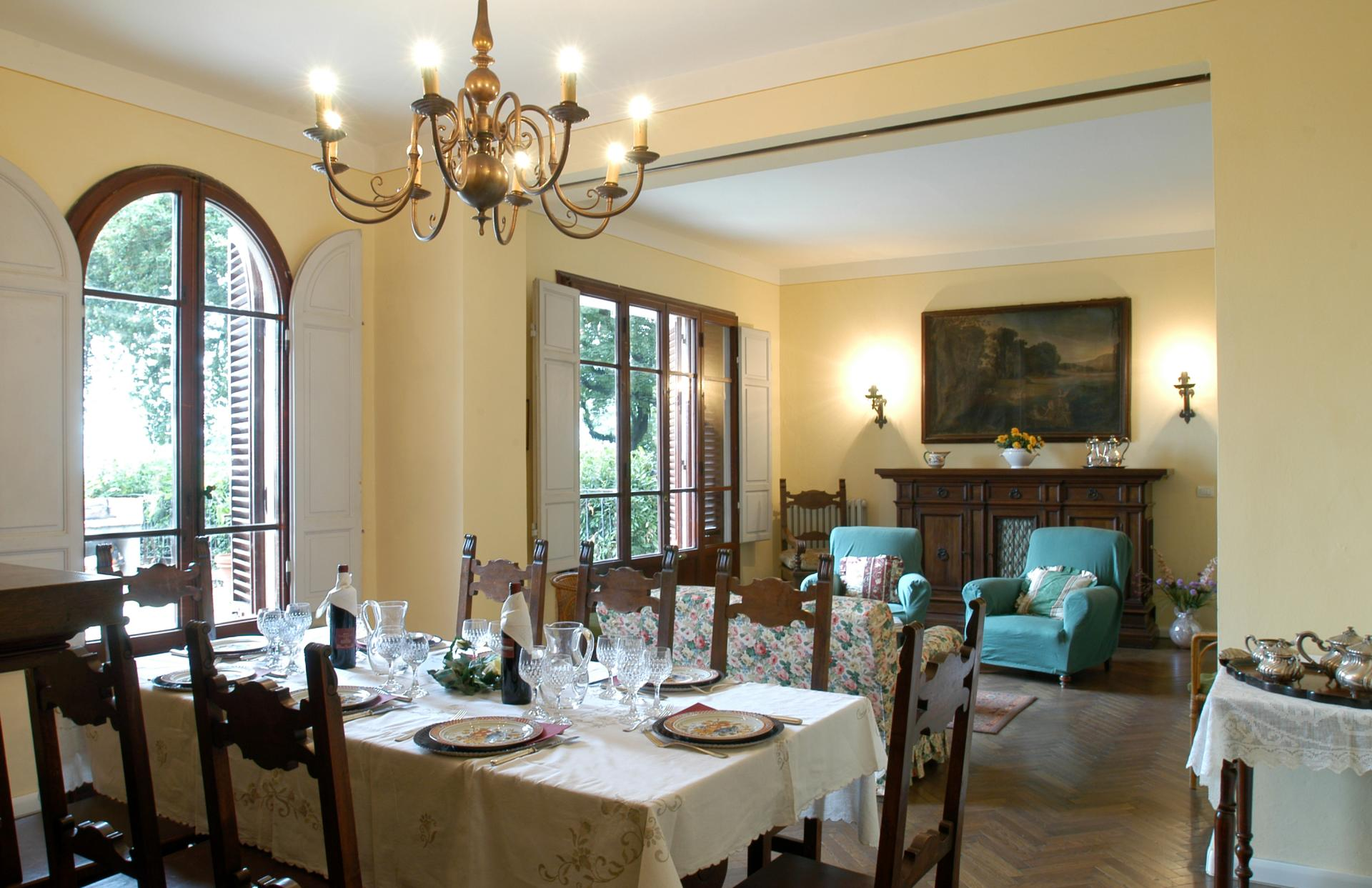 Dining room and lounge with fireplace, Borgo Raffaello, Tuscany, Pistoia.