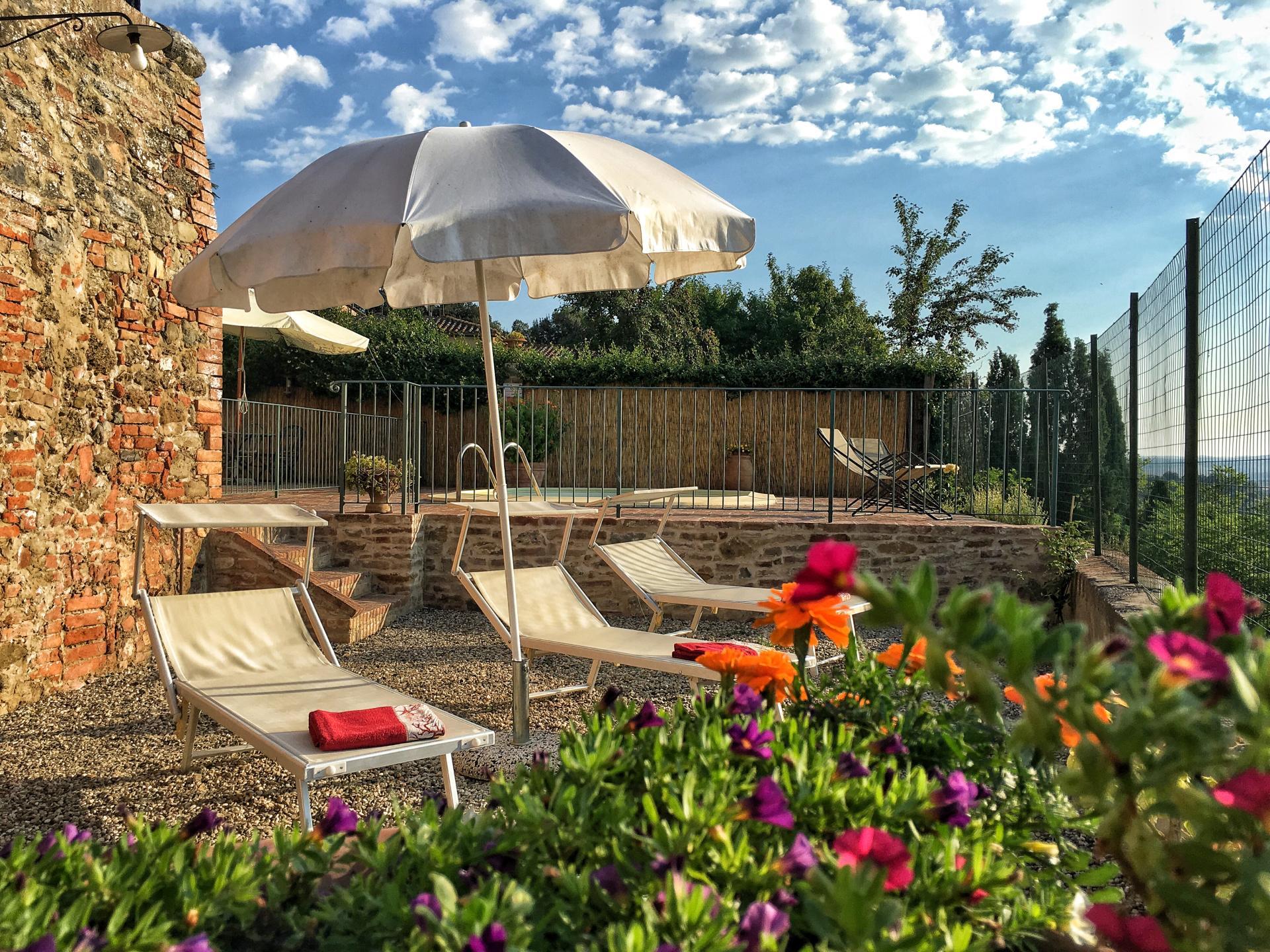 Sun loungers, Casa Giovanni, Tuscany, San Giovanni d'Asso.
