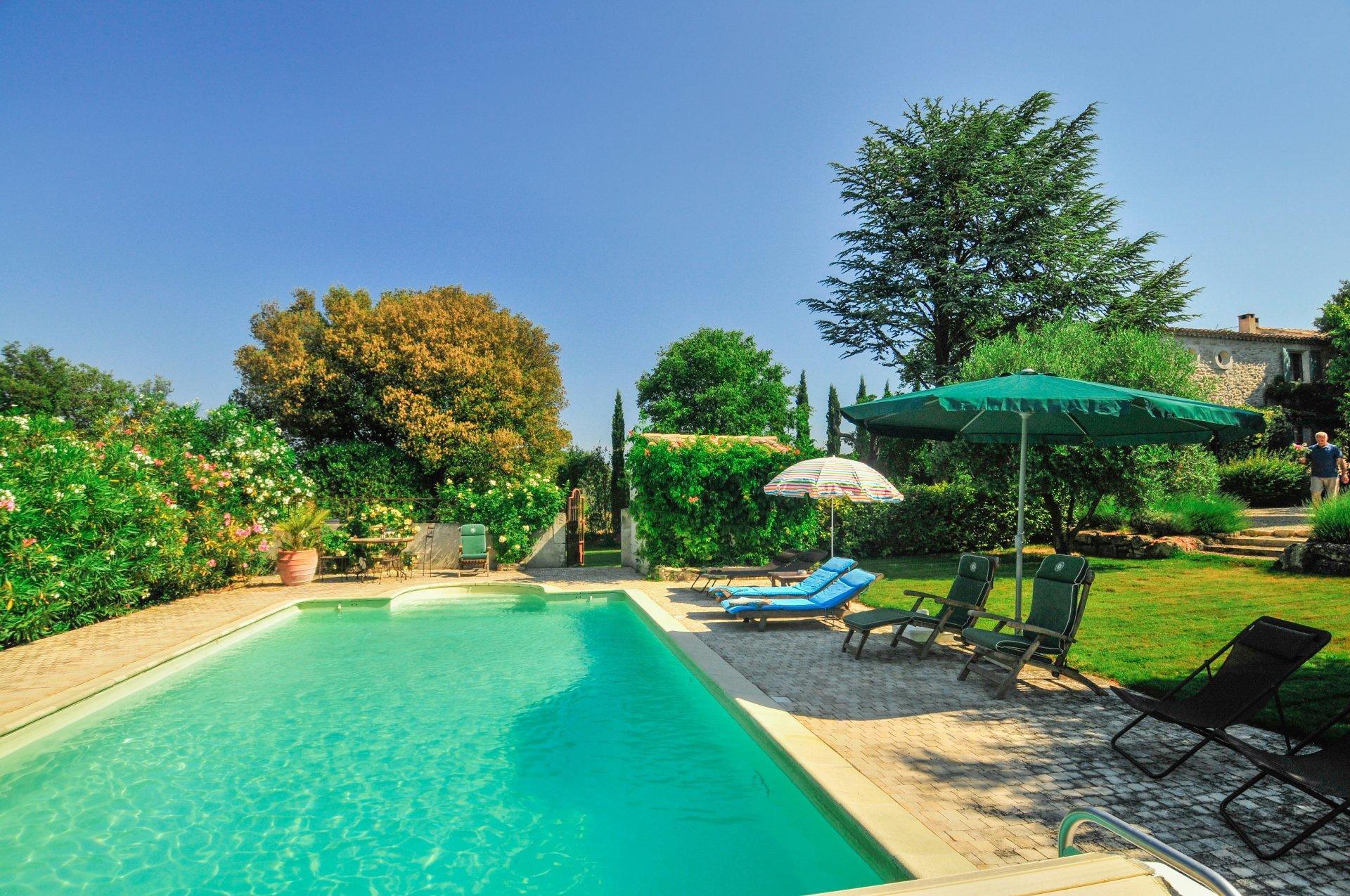 Large outdoor pool with sun loungers, Bastide St Restitut, Provence, St Restitut.