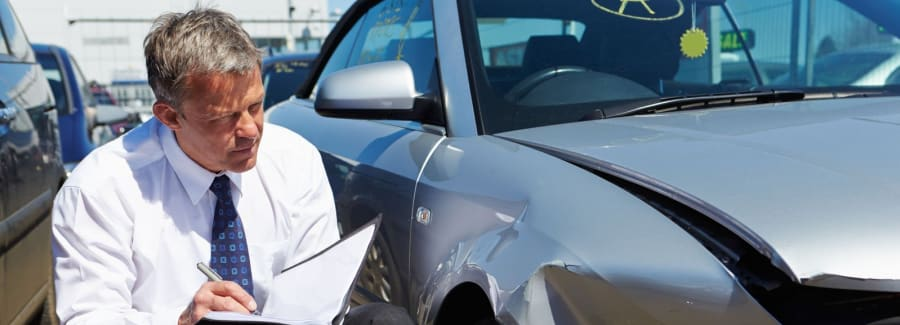A car insurance agent investigating an accident to make a claim.