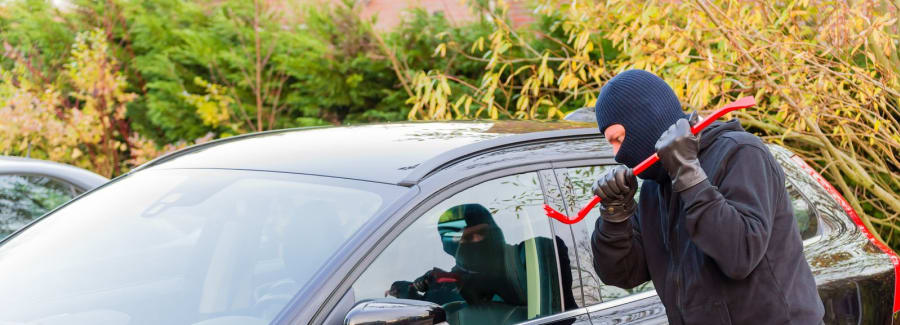 Man stealing car with crobar