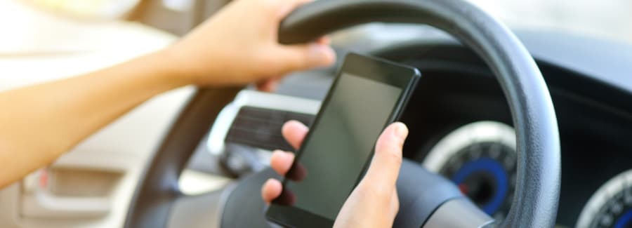 woman driver hands use cellphone driving a car