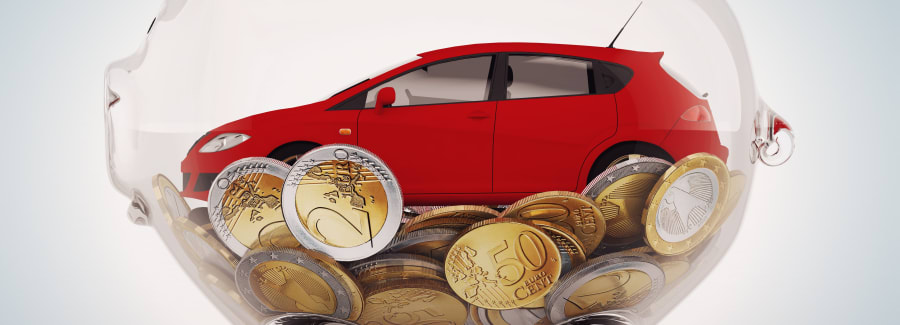 Transparent piggybank with coins and red car