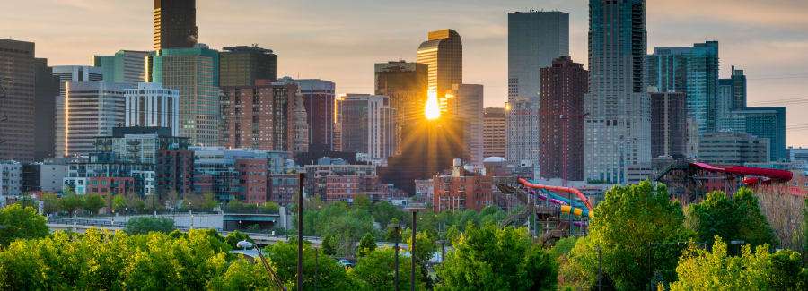 City of Denver Colorado with morning sun star