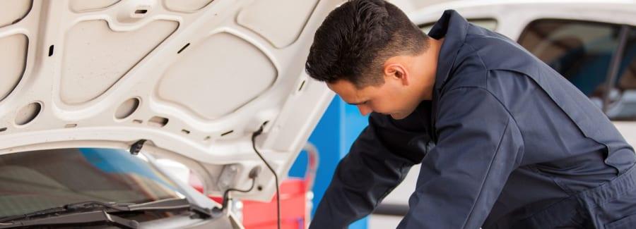 A mechanic making car repairs.