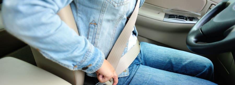 Man fastening seat belt.