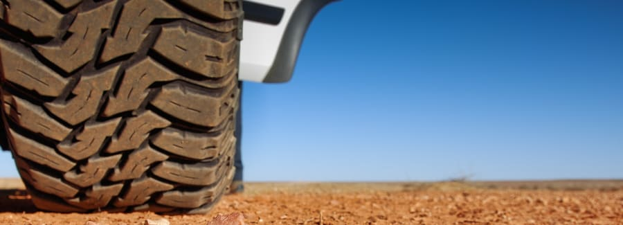 view of outback Australian desert, with car tyre in foreground.
