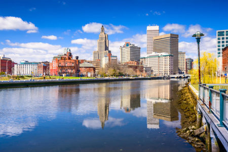 Providence, Rhode Island skyline on the river in fall with blue sky