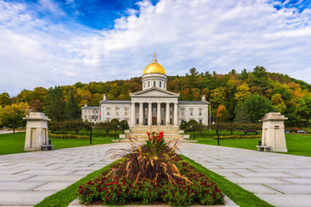 Vermont State House in Montpelier, Vermont in fall with blue sky and clouds