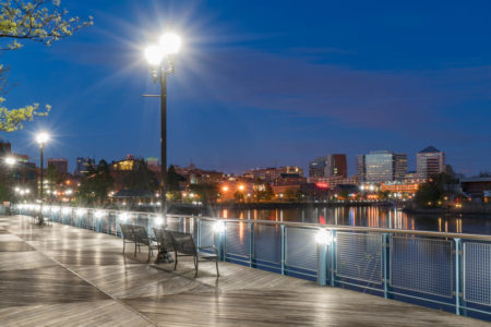 Wilmington, Delaware skyline along the Christiana River at night with street lamp