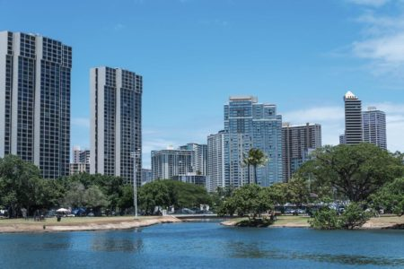 Ala Moana Beach Park in Honolulu, Hawaii with palm tree and blue sky