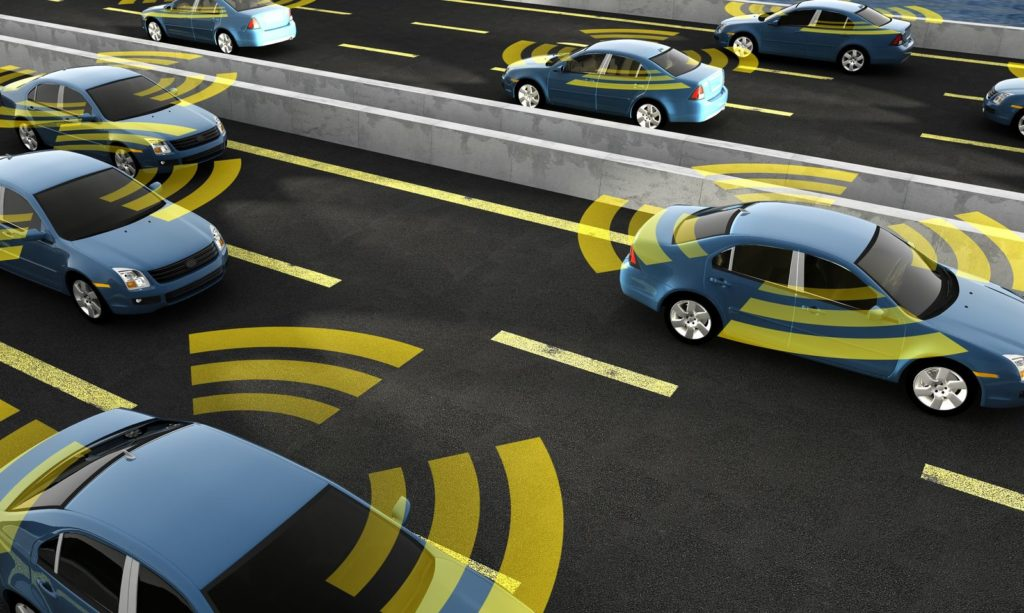 Cars with beams to illustrate their smart sensing technology