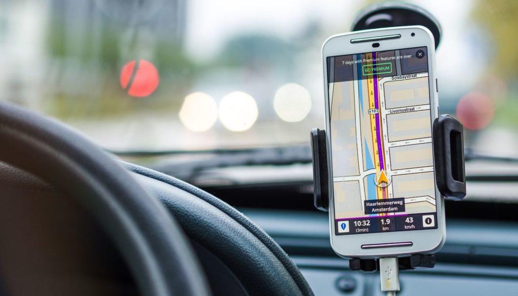 phone on holder navigating driver