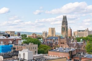 City skyline of New Haven, Connecticut with blue sky and clouds