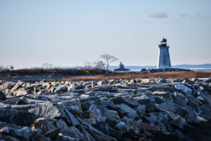 Lighthouse in Bridgeport, Connecticut with rocky shoreline