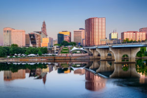 City skyline of Hartford, Connecticut by the river with blue sky