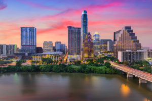 Downtown skyline of Austin, Texas near river with sunset