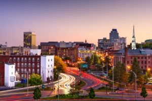 City skyline of Worcester, Massachusetts with car head lights and tail lights