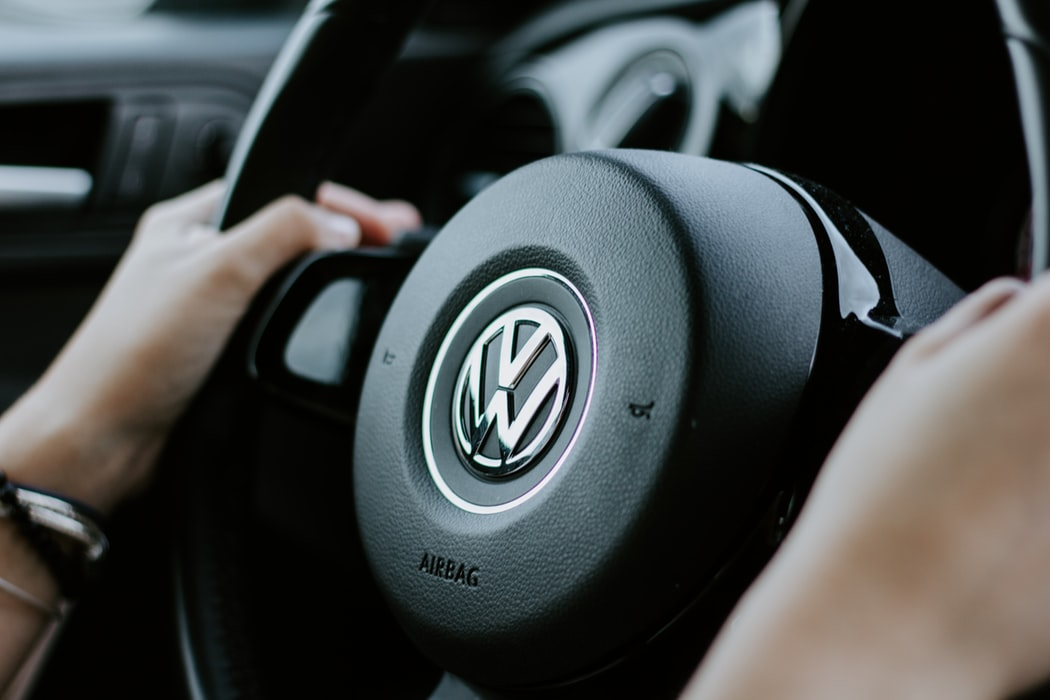 drivers hands at 10 and 2 on VW steering wheel