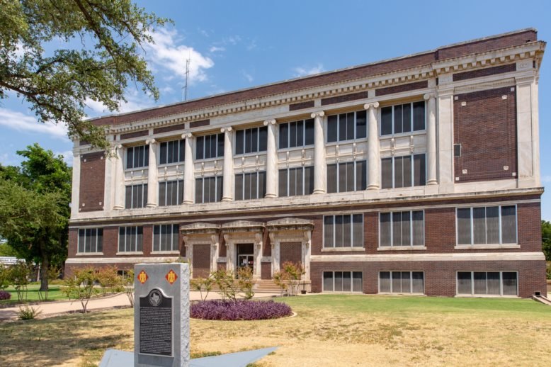 The historic 1914 Taylor County courthouse in Abilene Texas in Classical Revival style.