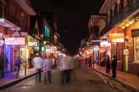 Bourbon Street in the French Quarter at night with lights in New Orleans, Louisiana, USA.