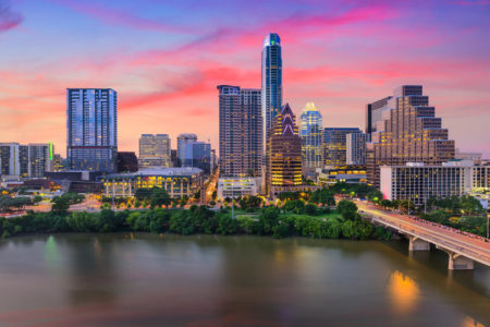 Downtown skyline of Austin, Texas near Colorado River with sunset.