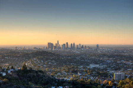 City of Los Angeles, California at dawn with sunrise and Pacific Ocean..